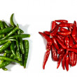 Heaps of red and green spicy peppers - Stock Photo