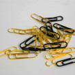 Black and Gold paper clip — Stock Photo