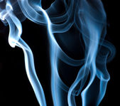 Blue smoke on black background — Stock Photo