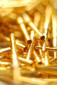 Abstract gold pins close-up — Stock Photo