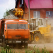 Lorry and loader — Stock Photo