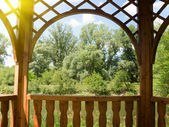 Arbour on the bank of the river — Stock Photo