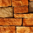 Wall of the house from a stone — Stock Photo