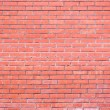 Wall from a brick of the red clay — Stock Photo