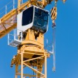 The crane elevating — Stock Photo