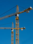 Cranes building two — Stock Photo