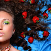 Portrait of beautiful woman with strawbarries in hair — Stock Photo