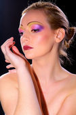 Young woman with bright make-up — Stock Photo