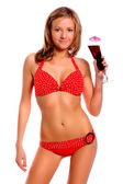 Young beautiful slim tanned woman in red swimsuit with a cocktail — Stock Photo
