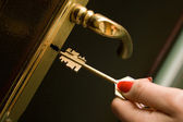 Hand, locking a key an iron door — Stock Photo