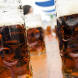 Mugs of dark beer on bavarifestival — Stock Photo #1284159