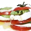 Tomato mozzarella salad with avocado - Stock Photo
