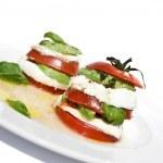 Tomato mozzarella salad with avocado — Stock Photo