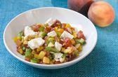Peach salad with feta & tomato — Stock Photo