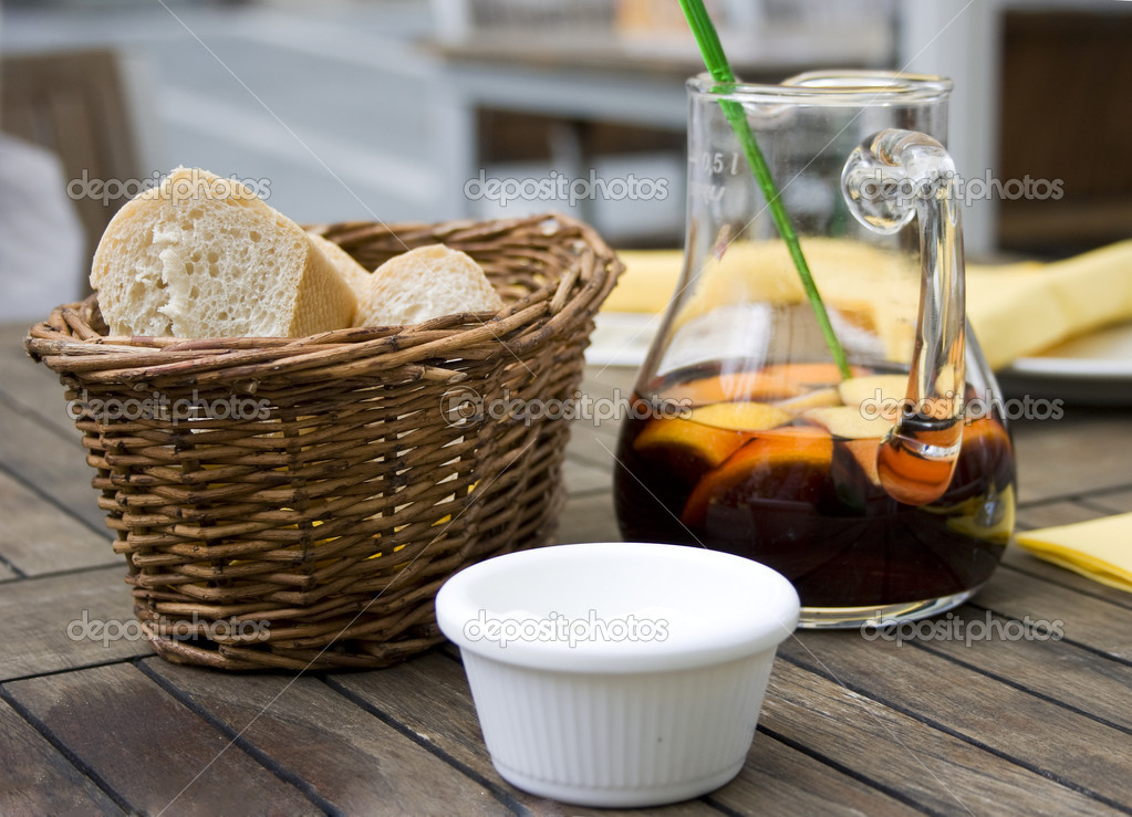 Red wine sangria and bread with spread in outdoor spanish cafe — Stock Photo #1293909