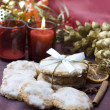 Christmas cookies on decorated table — Stock Photo