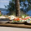 Tray of russian food with a sea view — Stock Photo