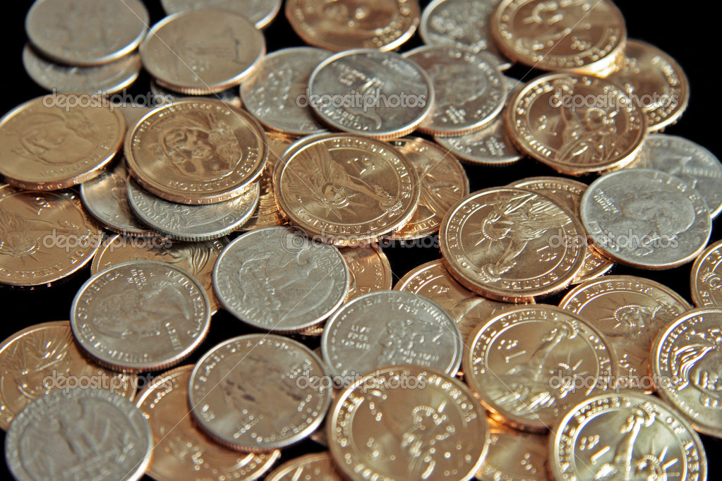 A single pile of gold U.S. one dollar coins and quarters  Stock Photo #1291385