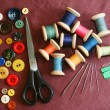 Stock Photo: Sewing kit on cotton cloth