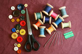 Sewing kit on a cotton cloth — Stock Photo