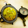 Old globe and compass — Stock Photo