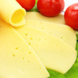 Foto de Stock  : Cheese, tomatoes and lettuce on the plat