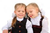 Portrait of two smiling kids isolated on white background — Stock Photo