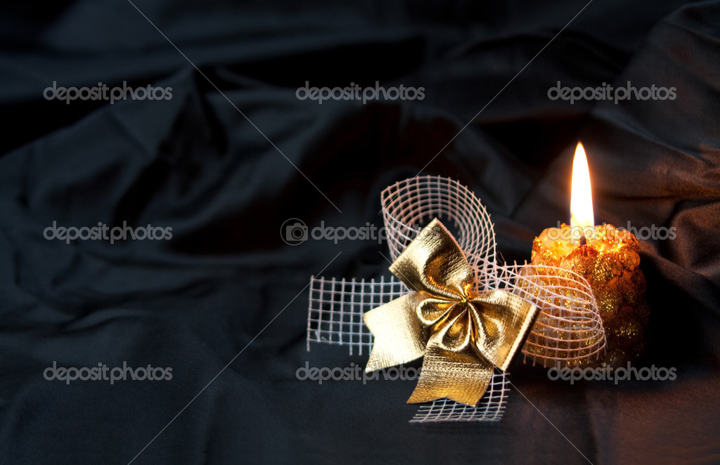 Candle and decoration on a black background  — Stock Photo #1836530
