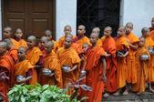 Buddha community, waiting for lunch — Stock Photo