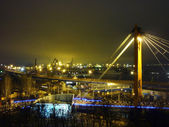 Seaport with cranes at night — Stock Photo