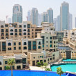 Swimming pool in Dubai downtown, UAE - Stok fotoğraf