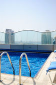 Swimming pool at the top of skyscraper — Stock Photo