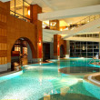 Swimming pool at night in modern hotel — Stock Photo