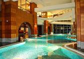 Swimming pool at night in modern hotel — Stock Photo