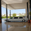 Limousine at hotel entrance — Stock Photo
