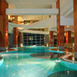 Swimming pool at night in modern hotel — Stock Photo #1298200