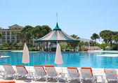 Swimming pool area in popular hotel — Stock Photo