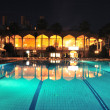 Swimming pool in night illumination — Stock Photo