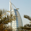 Burj al Arab hotel during sunset - Stock Photo