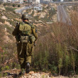 Israeli soldiers patrol in palestinian v — Stock Photo