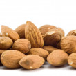 Stock Photo: Heap of almonds isolated