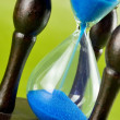 Hourglass on a green — Stock Photo