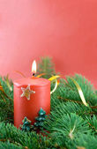 Fir branch and christmas candle — Stock Photo