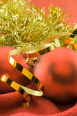 Christmas toys on a red — Stock Photo