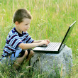 Child learns to laptop — Stock Photo