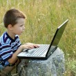 Child working on laptop — Stock Photo