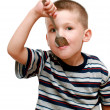 Little boy with a spoon in mouth — Stock Photo #1280132