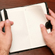 Hands with a notebook — Stock Photo #1283881