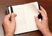 Hands with a notebook — Stock Photo