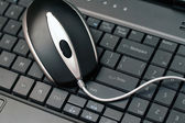 Wired mouse on a keyboard — Stock Photo